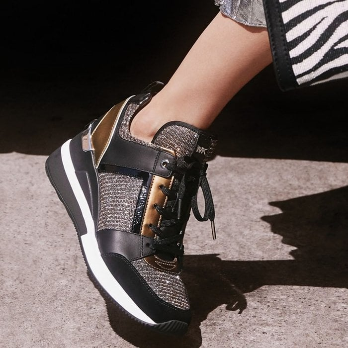 Mixed-media construction, metallic accents and a wedge heel add undeniable glamour to this sporty, street-chic Georgie sneaker