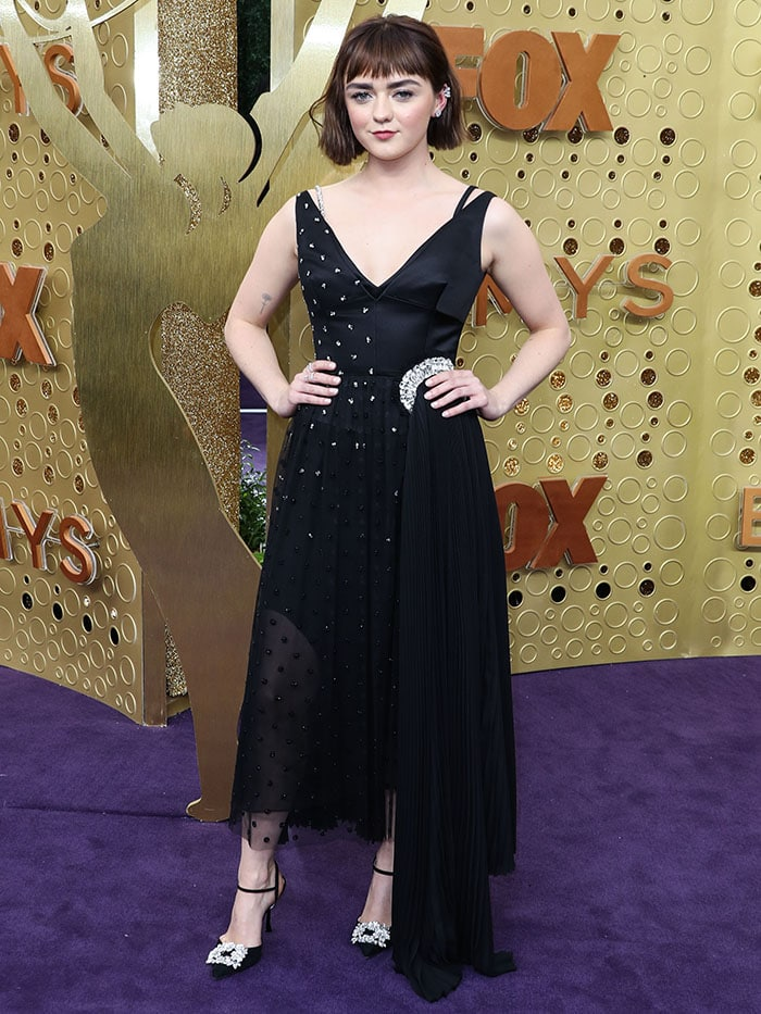Maisie Williams in a custom JW Anderson x Reuben Selby dres