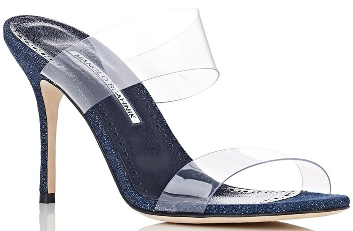 Manolo Blahnik's Scolto mules are styled with double clear PVC bands and a slim stiletto heel