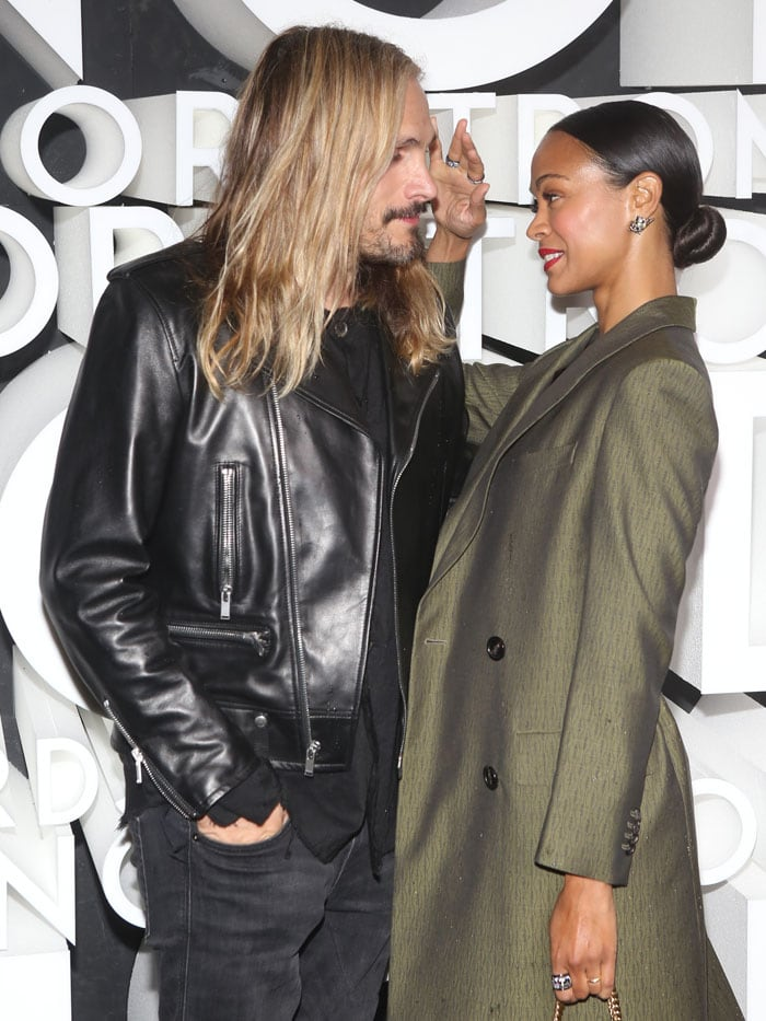Zoe Saldana brushing husband Marco Perego's long blond hair away from his face