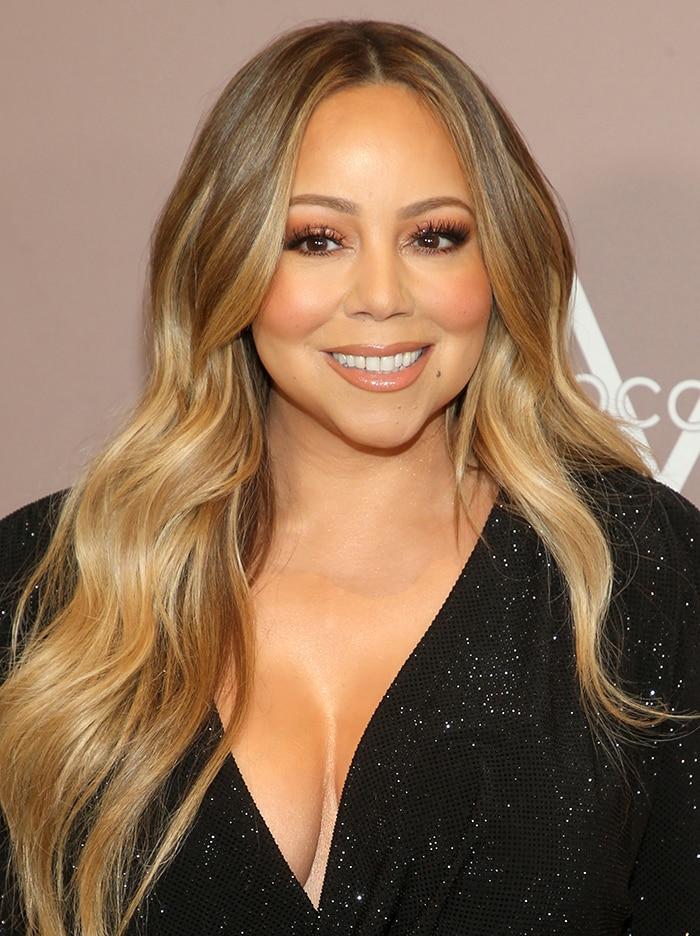 Mariah Carey wears her long tresses down in waves