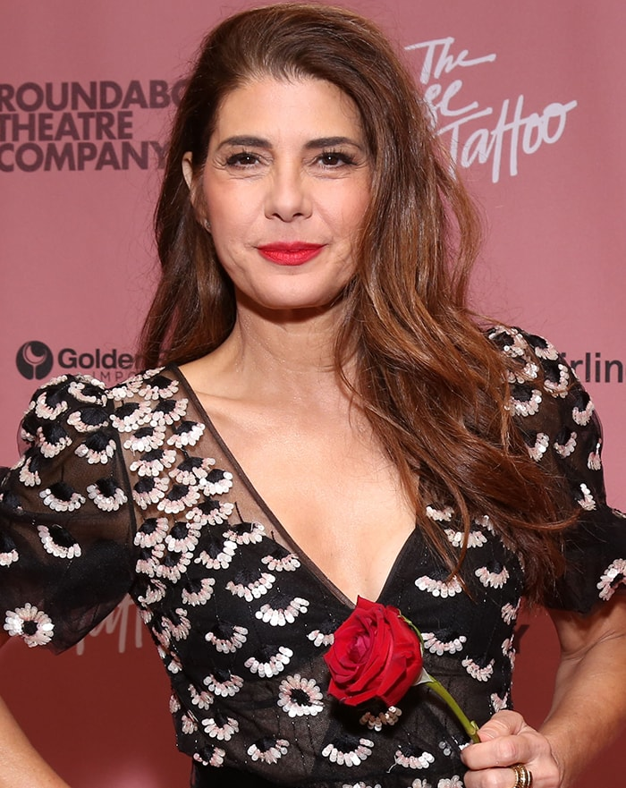 Marisa Tomei lets her long wavy hair down and wears scarlet lip shade