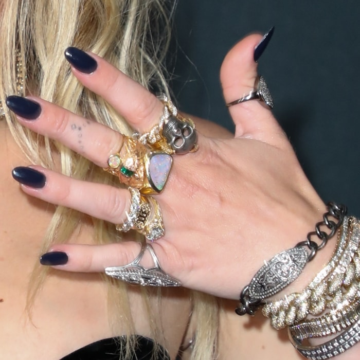 Miley Cyrus shows off her rings and body ink