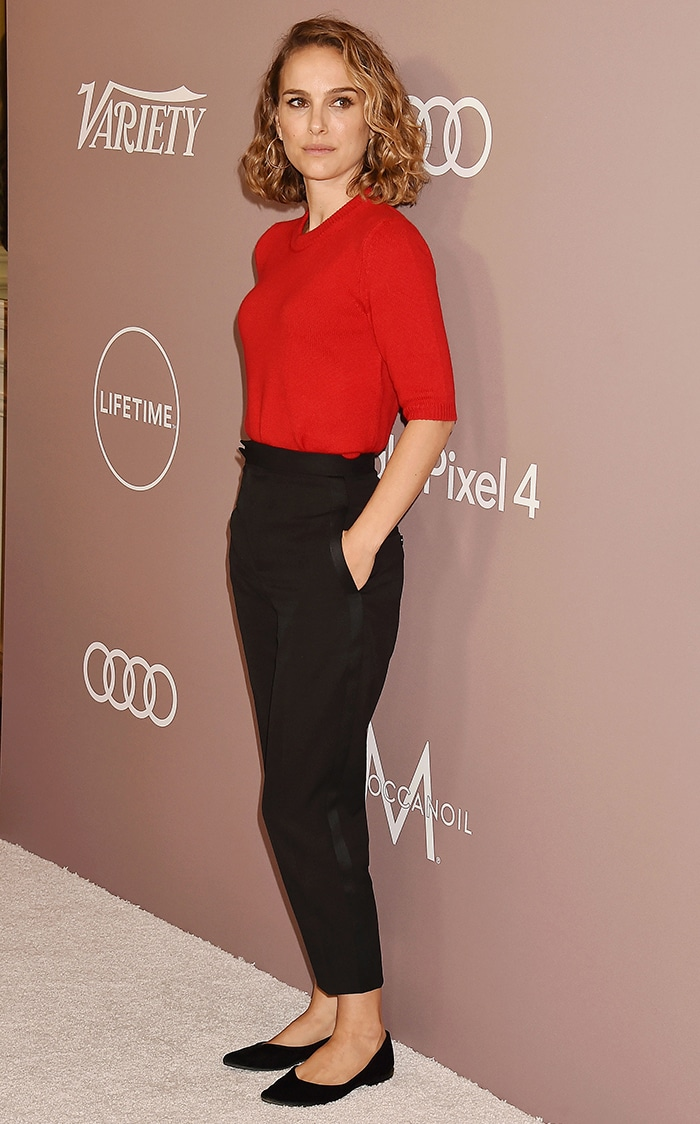 Natalie Portman keeps it simple in red Celine sweater and black trousers