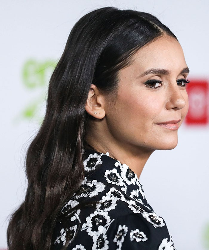Nina Dobrev with long hair sporting brunette waves done by hairstylist Johnnie Sapong and cat eyeliner by make-up artist Daniel Martin