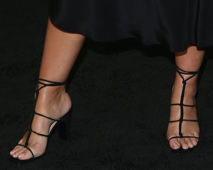 Pregnant Ashley Graham shows off her feet in Raye sandals