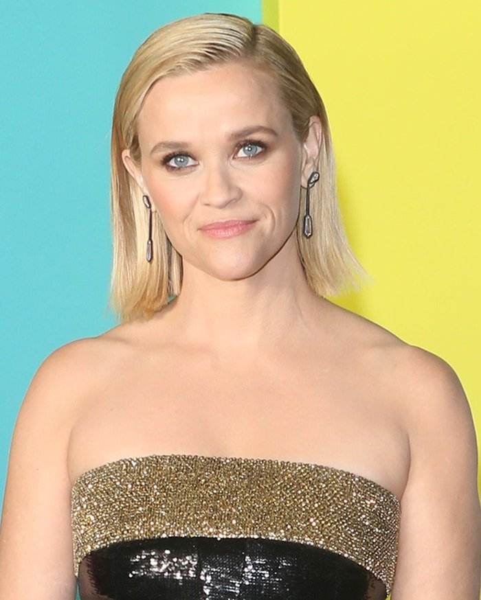 Reese Witherspoon rocks a slicked blunt bob hairstyle and smoky eye-makeup