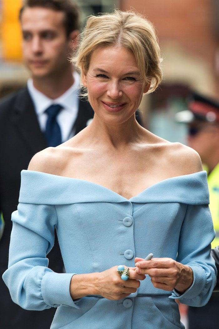 Renée Zellweger's Ulyana Sergeenko powder-blue off-shoulder dress showing off her sharp collarbones