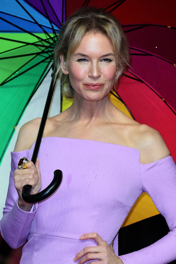 Renee Zellweger with a rainbow umbrella and a ruby ring