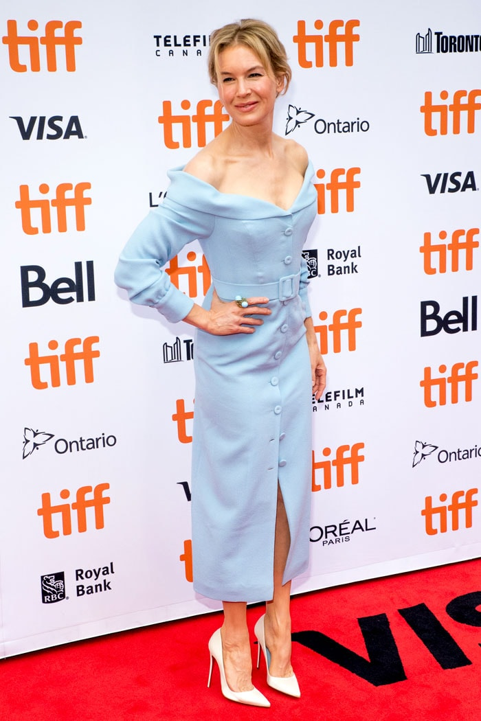 Renée Zellweger in a powder-blue off-shoulder dress and Christian Louboutin white-patent pumps