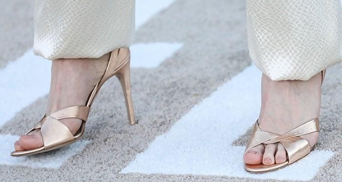 Rhea Seehorn's pretty feet in gold sandals
