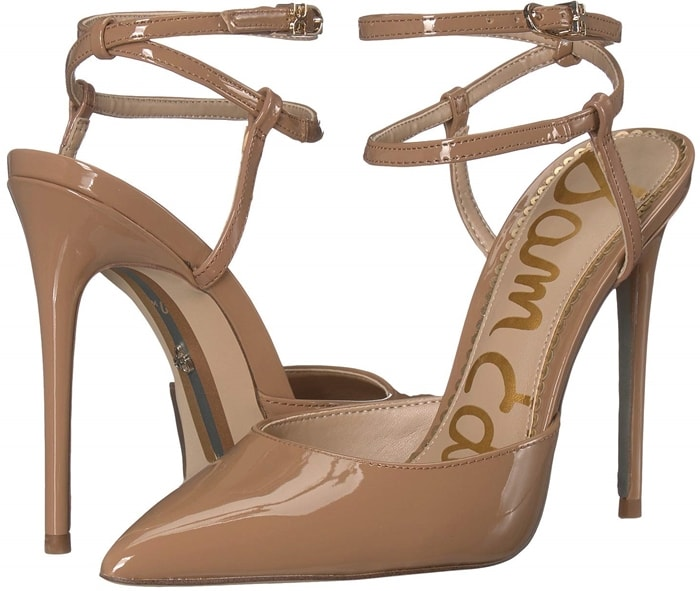 A fiercely stylish pump with a pointy toe and slim ankle strap that criss-crosses at the back is finished with a logo buckle and willowy stiletto heel