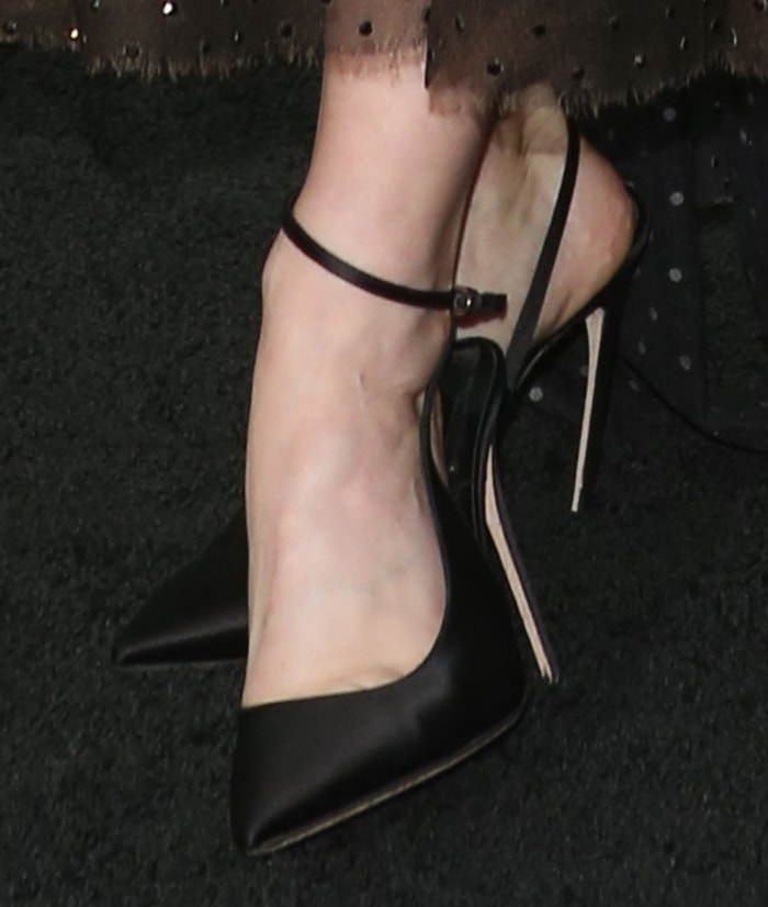 Sarah Jones flashes her feet in Brian Atwood pumps
