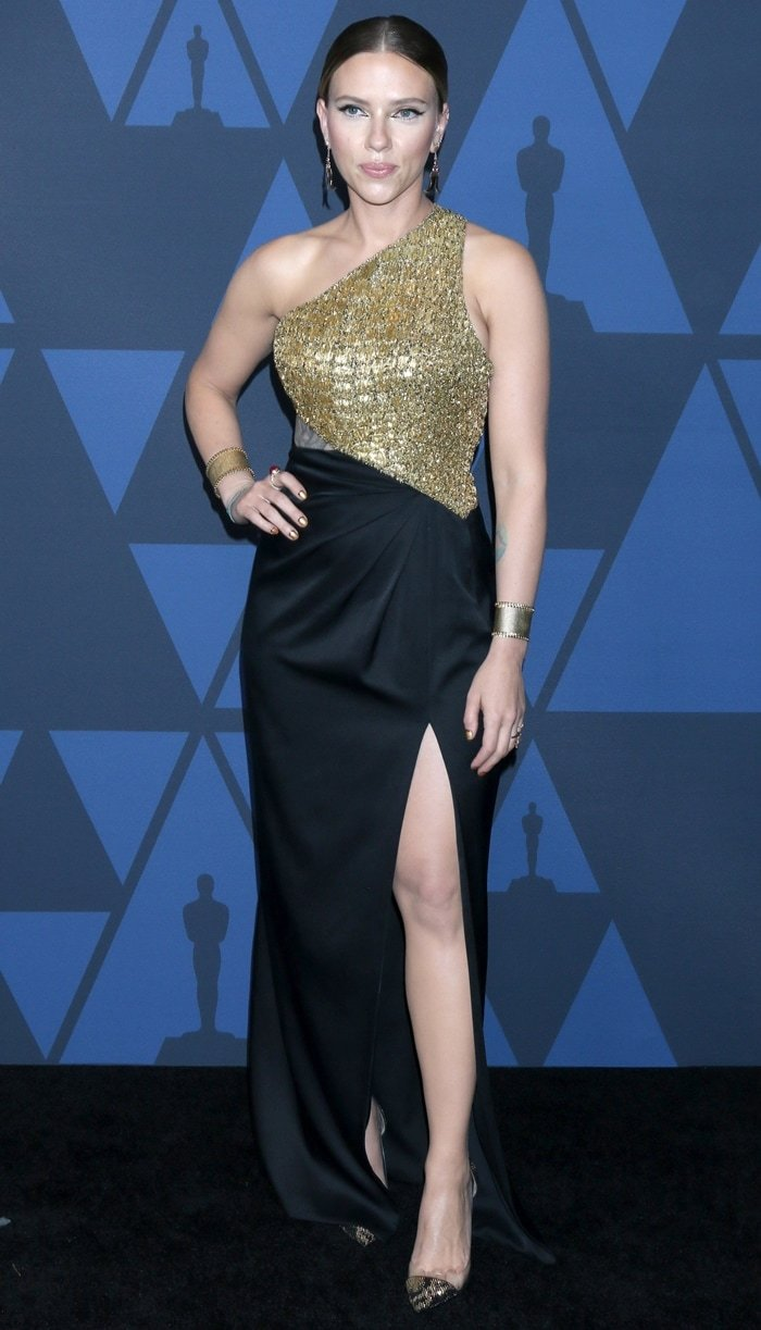 Scarlett Johansson strikes a pose on the black carpet at the 2019 Governors Awards