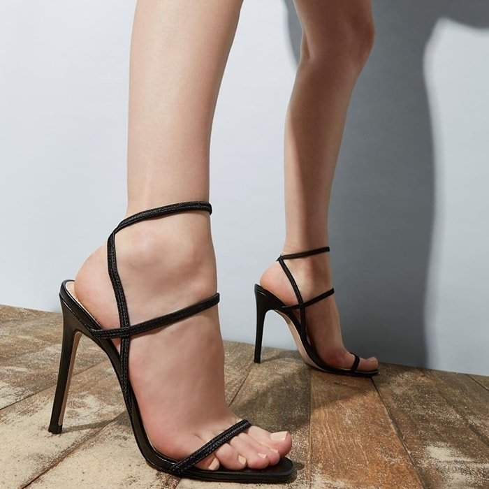 A trio of svelte straps define a fashion-forward sandal with a barely there silhouette