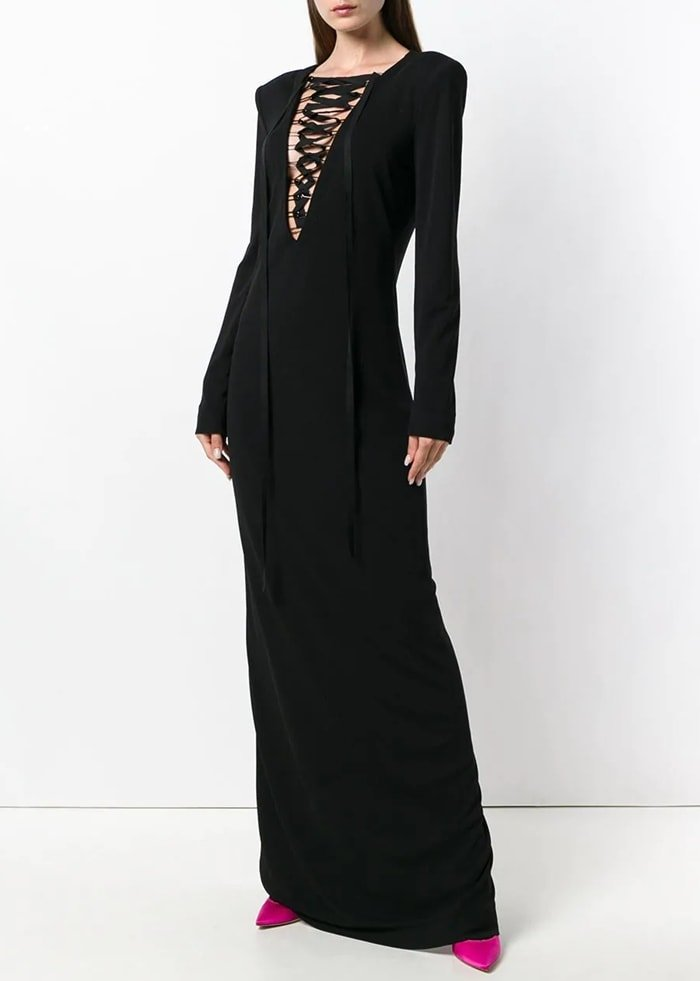 Black silk blend Sable lace-up gown from Tom Ford featuring structured shoulders, a deep V neck, long sleeves, a fitted silhouette, a draped design and metal loops on the deep v-neck with grosgrain lacing