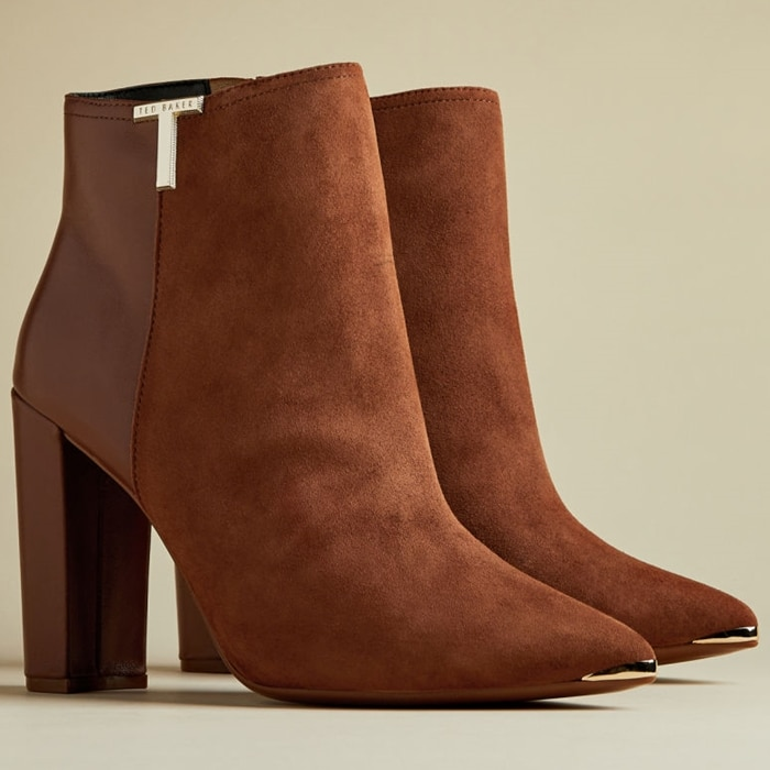 The Ted Baker Inala bootie with a combination suede and smooth leather upper with just the right amount of bright hardware creates a timeless look for the season