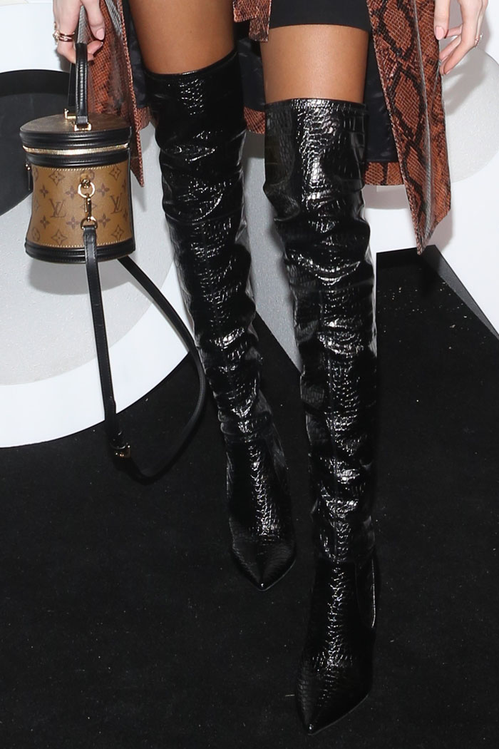 Details of Winnie Harlow's black croc-embossed thigh-high boots