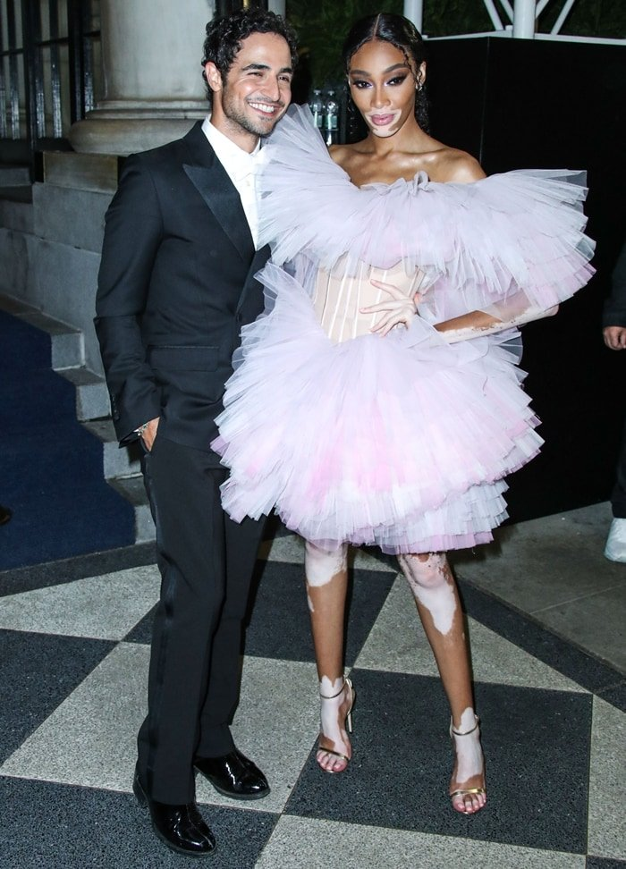 Zac Posen and Winnie Harlow arrive at the 2019 Harper's BAZAAR Celebration of 'ICONS By Carine Roitfeld'
