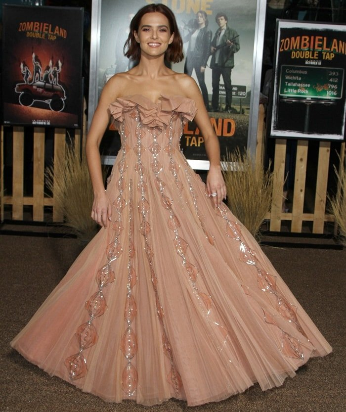 Zoey Deutch in a floor-length strapless nude dress at the premiere of Zombieland: Double Tap