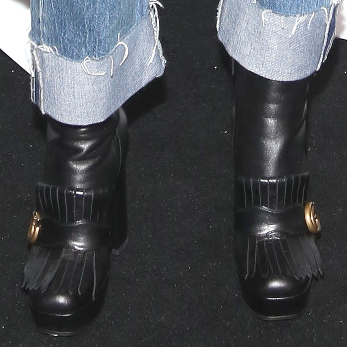 Closeup of Zosia Mamet's Gucci Marmont kiltie platform boots