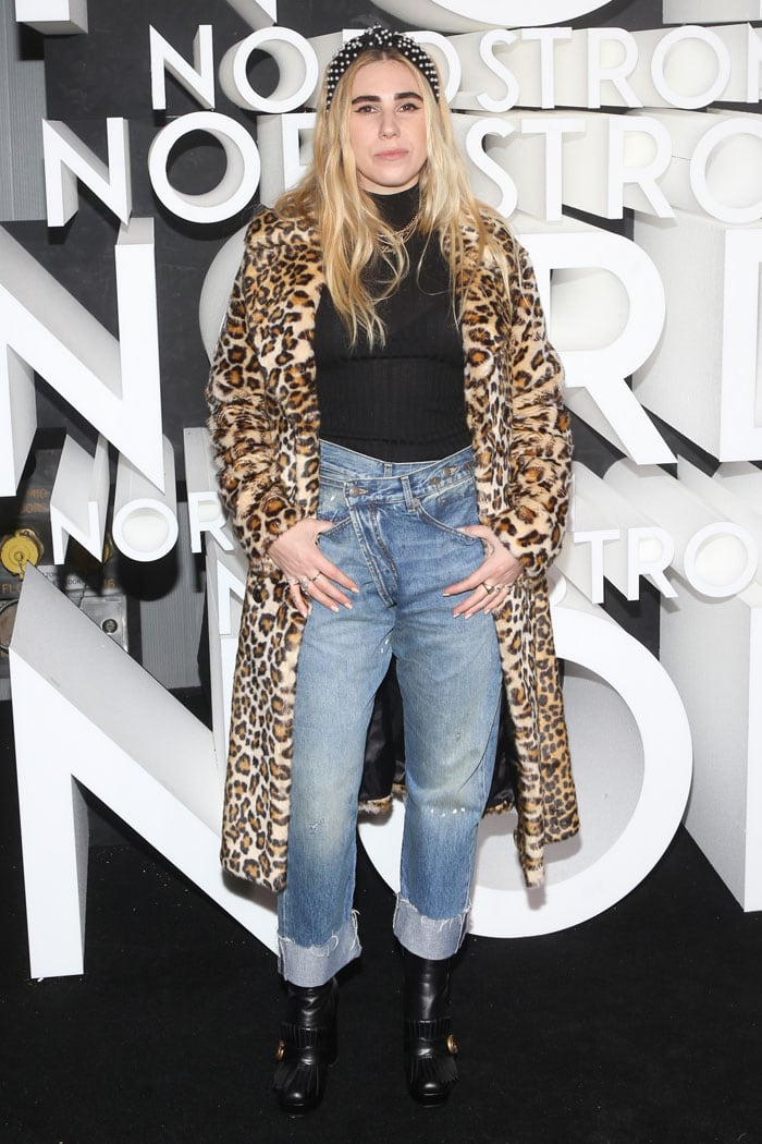 Zosia Mamet in a leopard fur coat, overlapped-waistband jeans, and Gucci platform boots