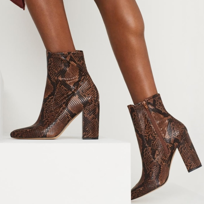 Separate from the pack in the Aldo Aurella booties featuring a synthetic leather upper on a block heel