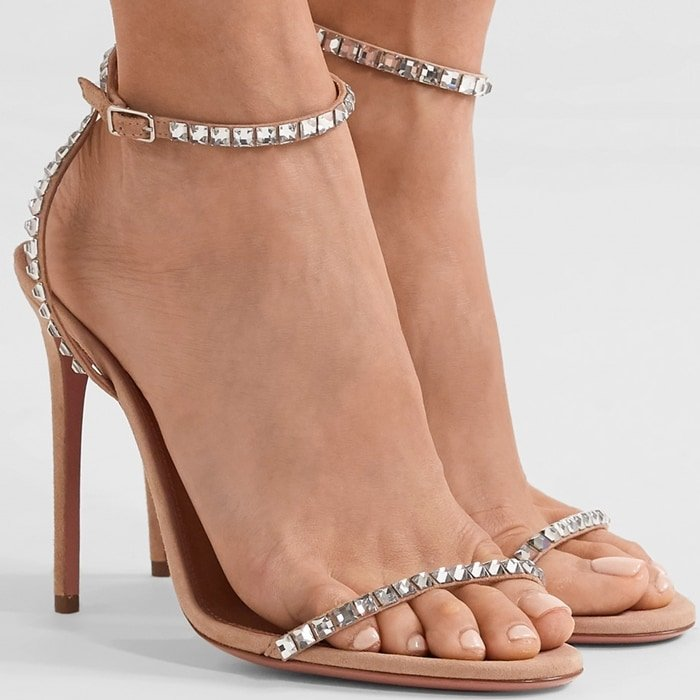 In a barely-there strappy silhouette, these nude suede sandals are accented with sparkling crystal trim