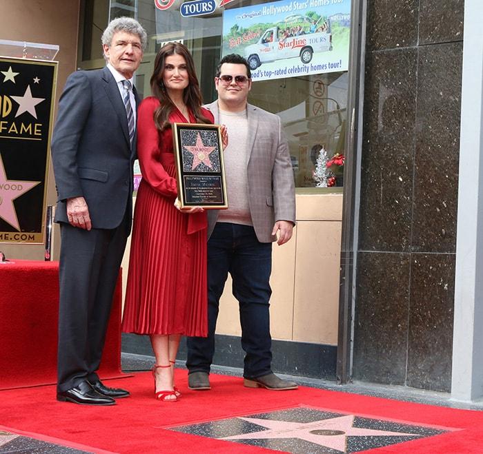 The Walt Disney Studios' co-chairman and chief creative officer Alan Horn and actor Josh Gad honor Idina Menzel