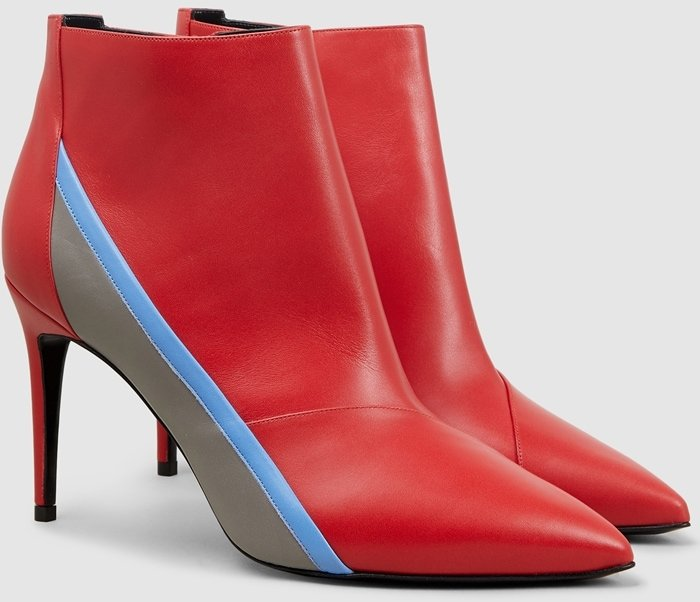 Fashioned with a pointed toe and spliced with an electric racing stripe, this red leather ankle boot has been crafted in Italy from smooth cherry-red leather, designed with a stiletto heel and inner zip fastening