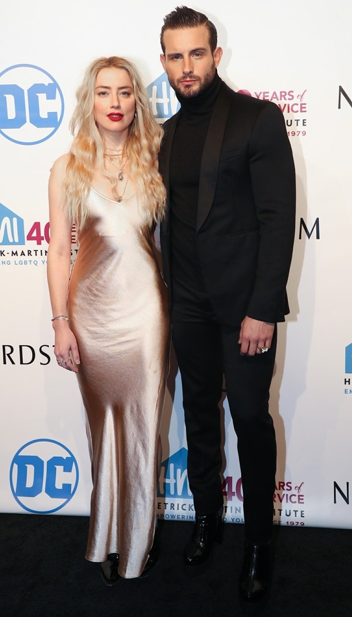 Amber Heard and Nico Tortorella pose together on the carpet while stepping out for the 2019 Emery Awards