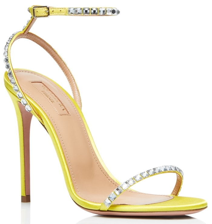 In a barely-there strappy silhouette, these yellow suede sandals are accented with sparkling crystal trim