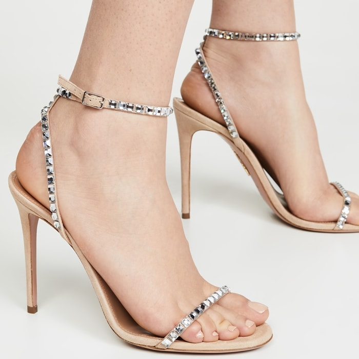 In a barely-there strappy silhouette, these suede sandals are accented with sparkling crystal trim
