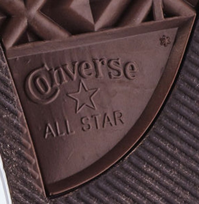 Inspect the outsole that shows the Converse logo