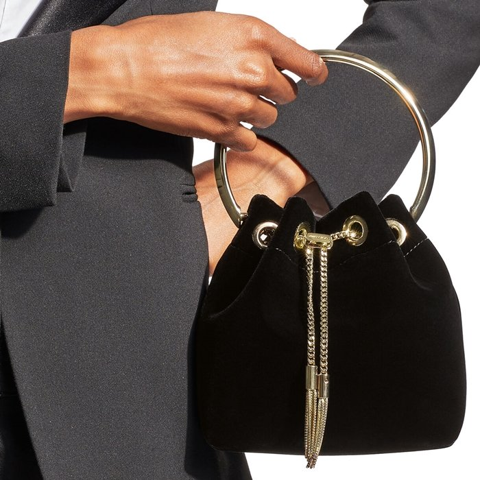Jimmy Choo's Bon Bon bag is topped with a chic bracelet top handle that allows you to carry it gracefully