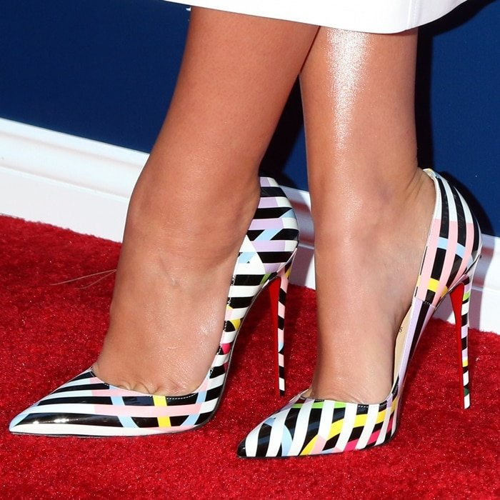 Camila Morrone's hot feet in colorful Cinestripes So Kate pumps by Christian Louboutin