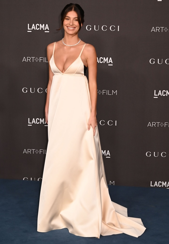 Camila Morrone worked the blue carpet