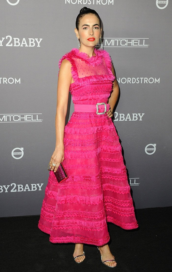 Camilla Belle looks festive in a Monique Lhuillier fuchsia dress