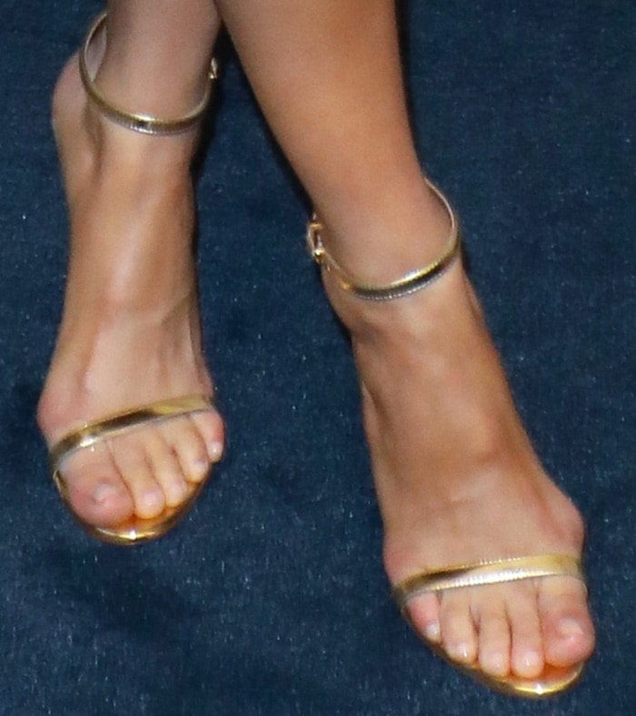 Camilla Belle shows off her pretty feet in classic gold sandals