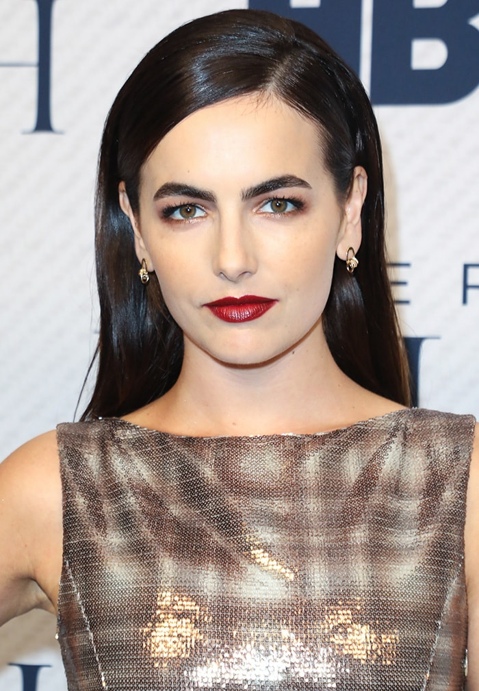 Camilla Belle wears '60s beehive hairstyle with bold red lipstick