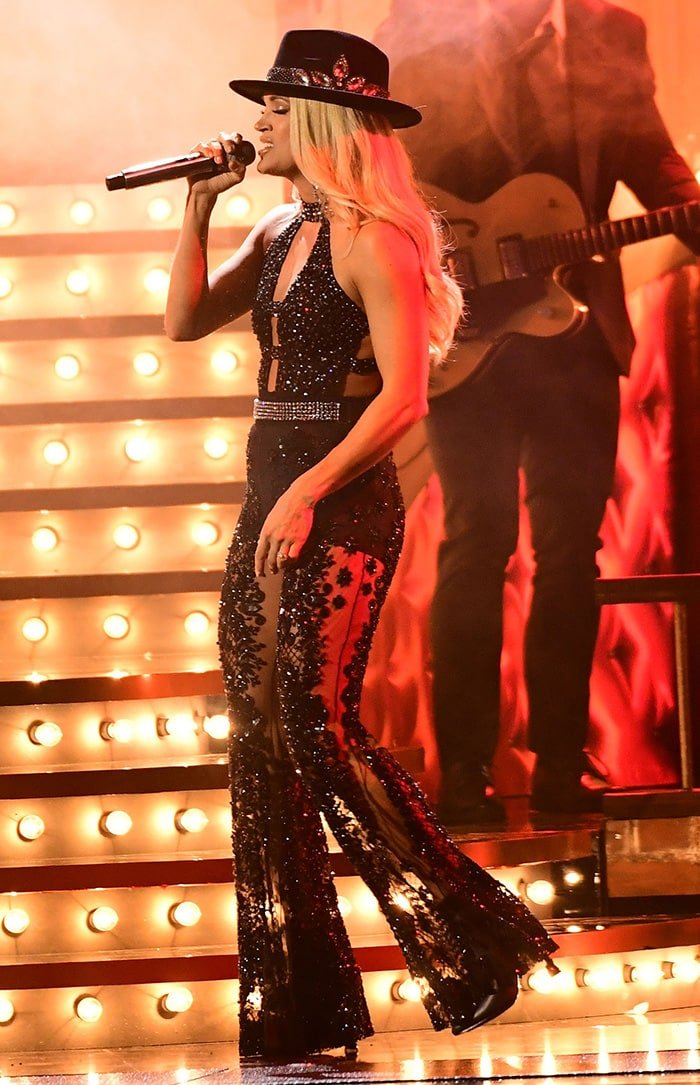 Carrie Underwood shows a glimpse of flesh in embellished bodysuit and sheer pants