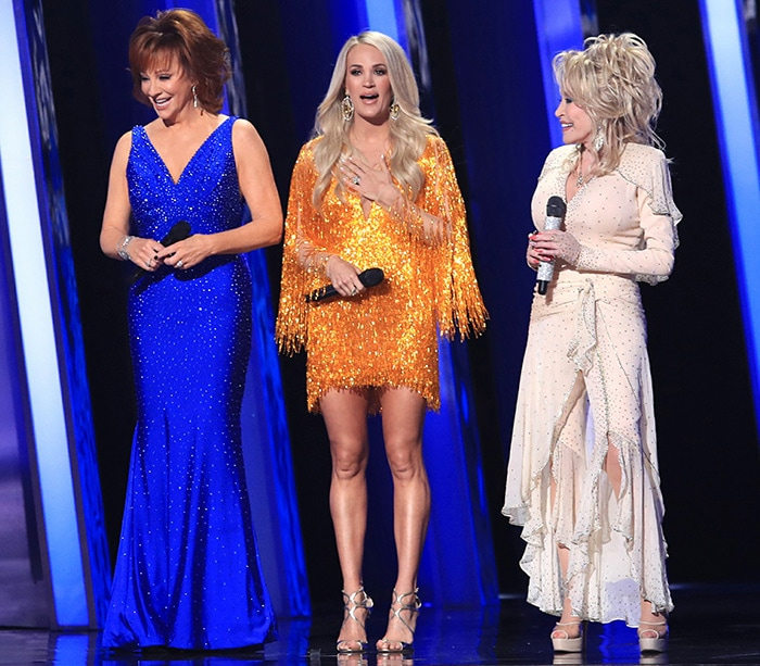 Carrie Underwood puts her legs on display as she co-hosts the 2019 CMA Awards