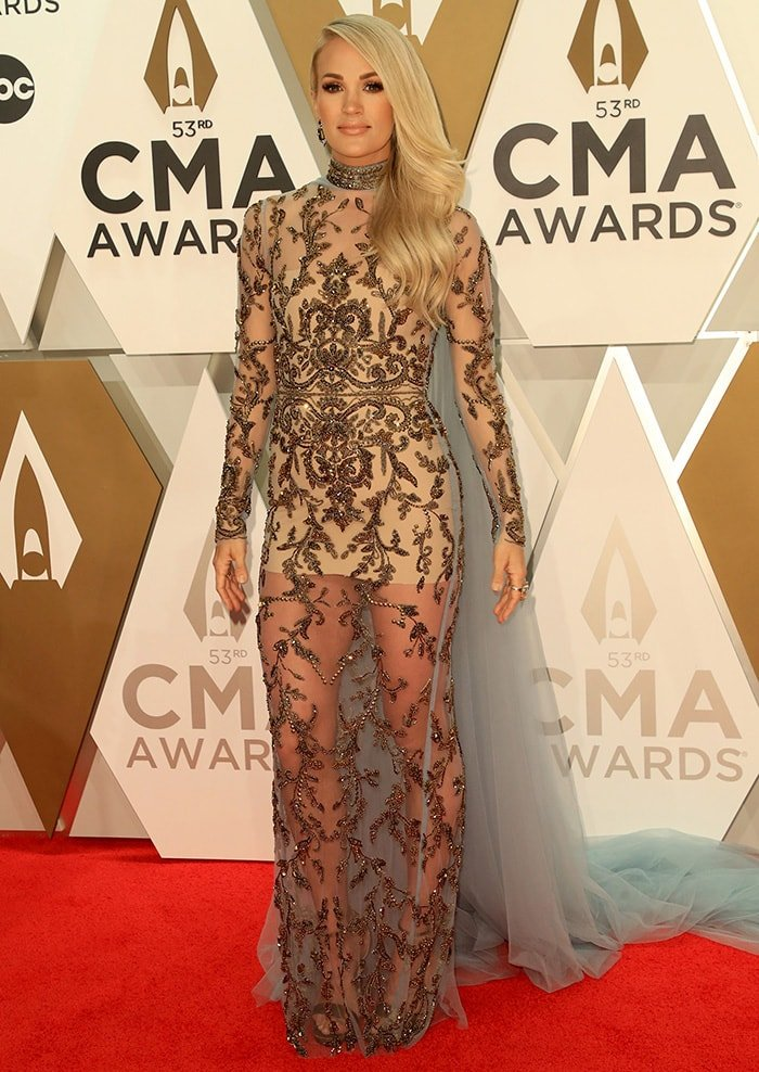 Carrie Underwood walks the red carpet in Elie Madi dress