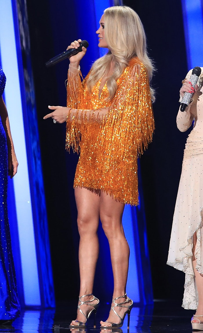 Carrie Underwood switches into a Nicole and Felicia tinsel fringed mini inside the Bridgestone Arena