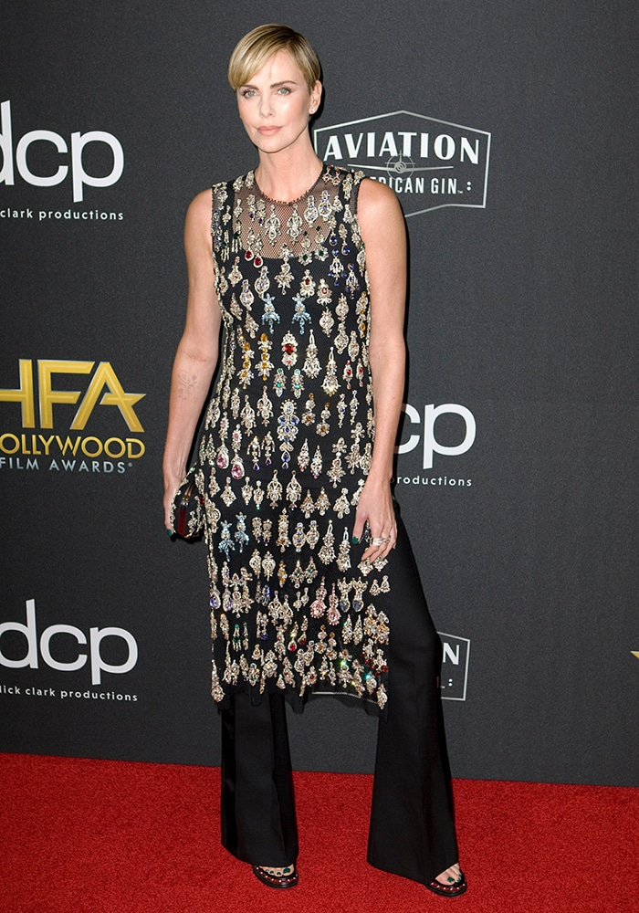 Charlize Theron glimmers in Alexander McQueen crystal-embellished sheer tunic top