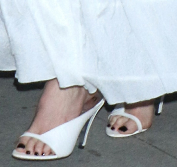Charlize Theron shows off her feet in white Givenchy sandals