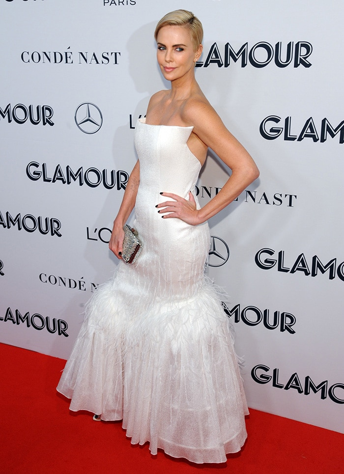 Charlize Theron wears a glamorous white Givenchy strapless gown