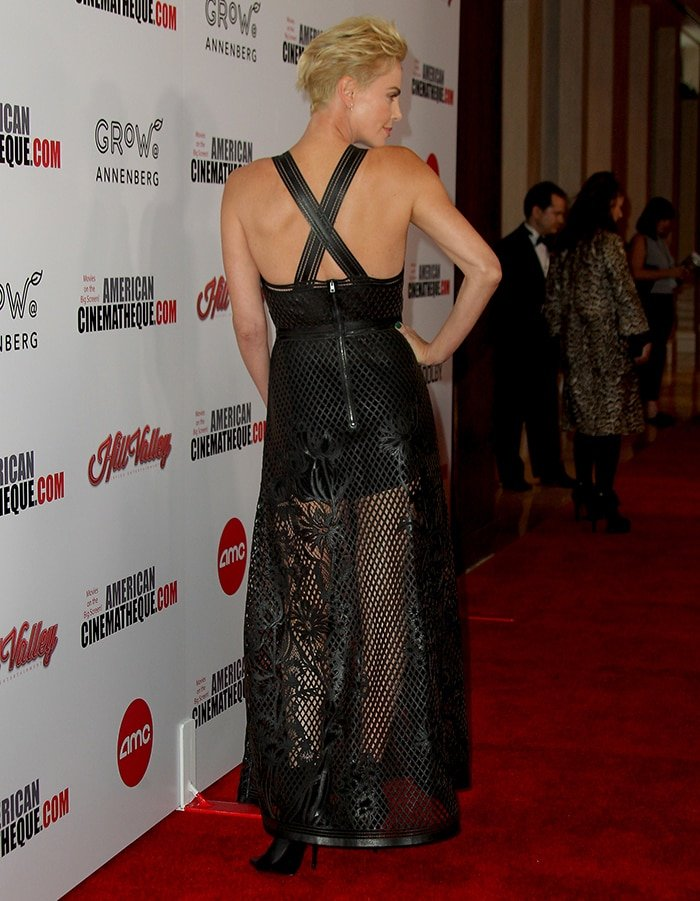 Charlize Theron shows her sexy back in a Christian Dior spring 2020 leather cutout embroidered dress