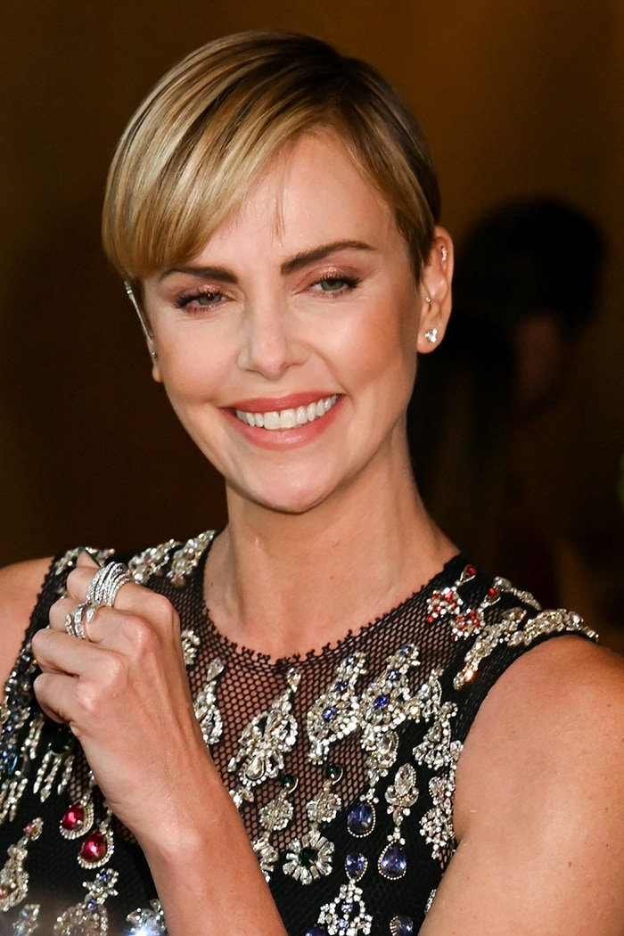 Charlize Theron wears glittery pink eyeshadow with peachy blush and lipshade