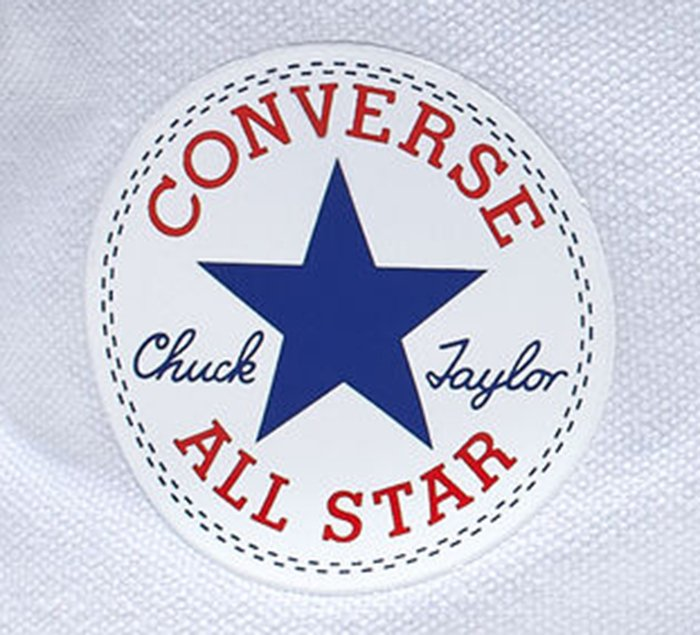 "CONVERSE ALL STAR"" in red uppercase letters and Chuck Taylor signature in navy blue script with a five-pointed star"